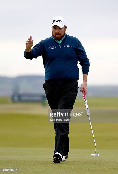 Shane Lowry of Ireland acknowledges the crowd after holing his putt on the nineth green during the second round of the 2014 Alfred Dunhill Links...