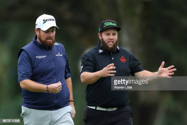 Shane Lowry of Ireland and Andrew Johnston of England walk down the 14th hole during day one of the Andalucia Valderrama Masters at Real Club...