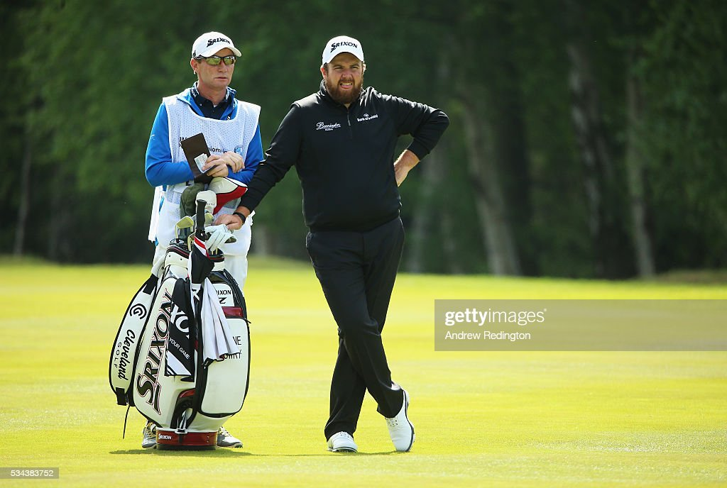 <a gi-track='captionPersonalityLinkClicked' href=/galleries/search?phrase=Shane+Lowry+-+Golfer&family=editorial&specificpeople=12866010 ng-click='$event.stopPropagation()'>Shane Lowry</a> of Ireland and caddie Dermot Byrne look down the 9th hole during day one of the BMW PGA Championship at Wentworth on May 26, 2016 in Virginia Water, England.