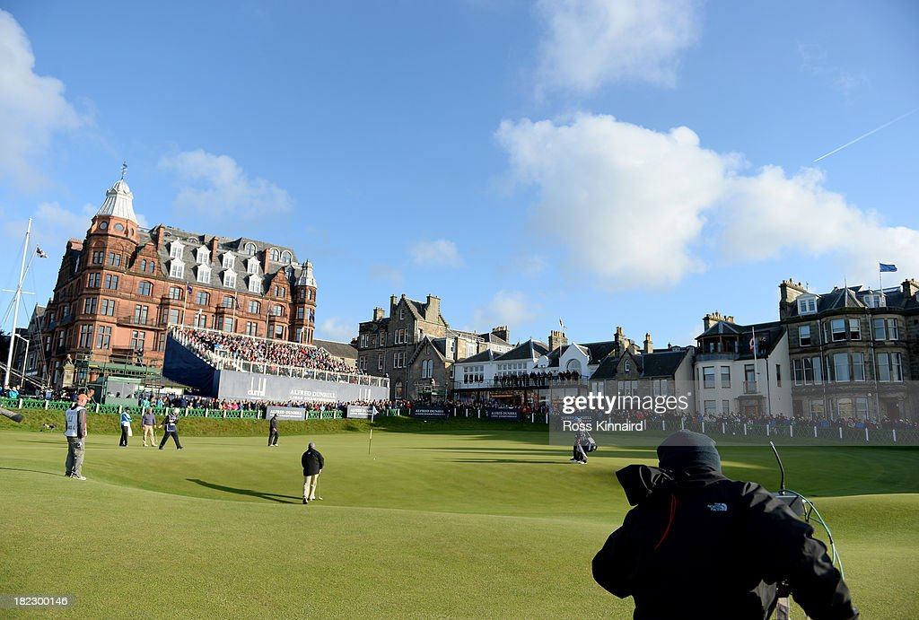 Shane Lowry of Ireland and Gerry McManus on the 18th green during the final round of the Alfred Dunhill Links Championship on The Old Course, at St Andrews on September 29, 2013 in St Andrews, Scotland.