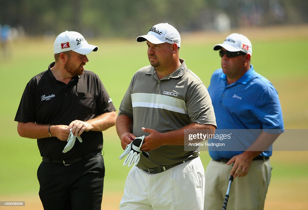 Shane Lowry of Ireland Brendon de Jonge of Zimbabwe and Kevin Stadler of the United States wait together during the first round of the 114th US Open...
