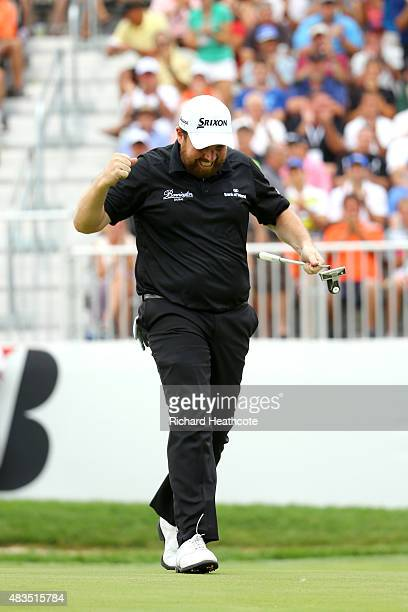 Shane Lowry of Ireland celebrates after a birdie putt on the 18th green during the final round of the World Golf Championships Bridgestone...