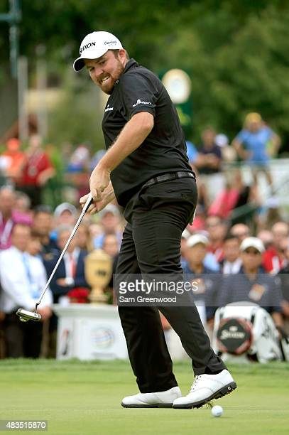 Shane Lowry of Ireland celebrates as his birdie putt falls in the cup on the 18th green during the final round of the World Golf Championships...
