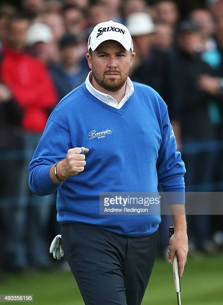 Shane Lowry of Ireland celebrates holing a birdie putt on the 18th green during day two of the BMW PGA Championship at Wentworth on May 23 2014 in...