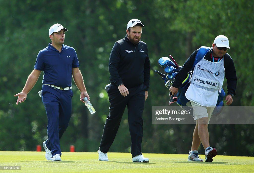 <a gi-track='captionPersonalityLinkClicked' href=/galleries/search?phrase=Shane+Lowry+-+Golfer&family=editorial&specificpeople=12866010 ng-click='$event.stopPropagation()'>Shane Lowry</a> of Ireland chats to <a gi-track='captionPersonalityLinkClicked' href=/galleries/search?phrase=Francesco+Molinari&family=editorial&specificpeople=637481 ng-click='$event.stopPropagation()'>Francesco Molinari</a> of Italy (L) during day one of the BMW PGA Championship at Wentworth on May 26, 2016 in Virginia Water, England.