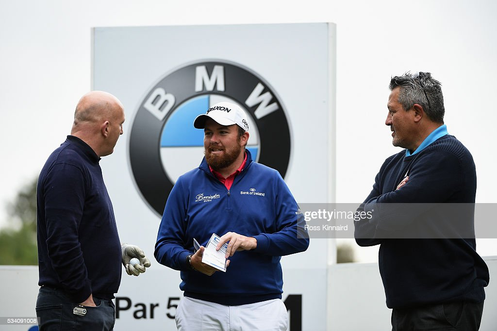 <a gi-track='captionPersonalityLinkClicked' href=/galleries/search?phrase=Shane+Lowry+-+Golf&family=editorial&specificpeople=12866010 ng-click='$event.stopPropagation()'>Shane Lowry</a> of Ireland chats with <a gi-track='captionPersonalityLinkClicked' href=/galleries/search?phrase=Keith+Wood&family=editorial&specificpeople=855185 ng-click='$event.stopPropagation()'>Keith Wood</a> (L) and <a gi-track='captionPersonalityLinkClicked' href=/galleries/search?phrase=Zinzan+Brooke&family=editorial&specificpeople=781933 ng-click='$event.stopPropagation()'>Zinzan Brooke</a> (R) during the Pro-Am prior to the BMW PGA Championship at Wentworth on May 25, 2016 in Virginia Water, England.