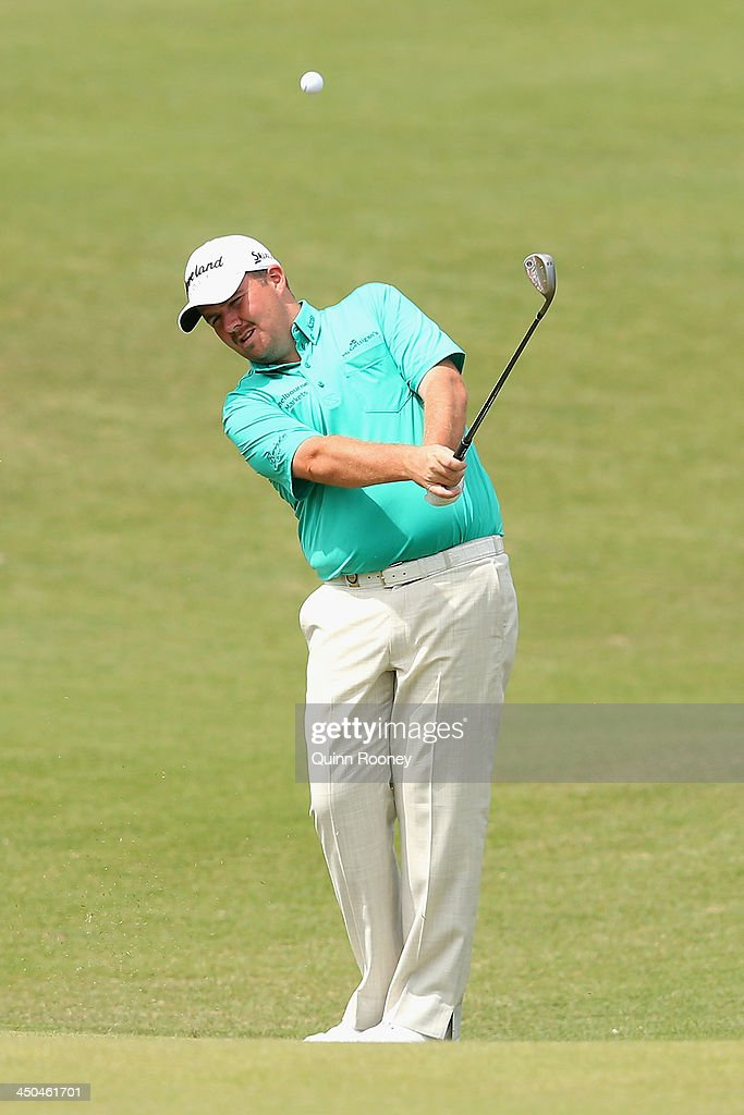 <a gi-track='captionPersonalityLinkClicked' href=/galleries/search?phrase=Shane+Lowry+-+Golfer&family=editorial&specificpeople=12866010 ng-click='$event.stopPropagation()'>Shane Lowry</a> of Ireland chips to the green during practice ahead of the World Cup Of Golf at Royal Melbourne Golf Course on November 19, 2013 in Melbourne, Australia.