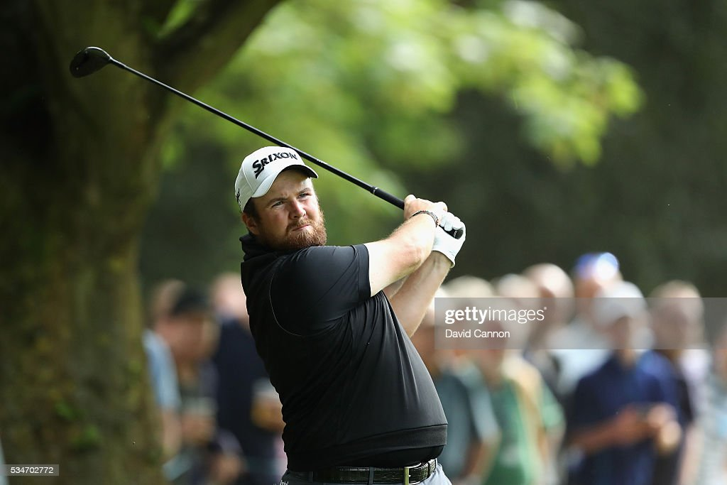 <a gi-track='captionPersonalityLinkClicked' href=/galleries/search?phrase=Shane+Lowry+-+Golfer&family=editorial&specificpeople=12866010 ng-click='$event.stopPropagation()'>Shane Lowry</a> of Ireland hits his 2nd shot on the 17th hole during day two of the BMW PGA Championship at Wentworth on May 27, 2016 in Virginia Water, England.