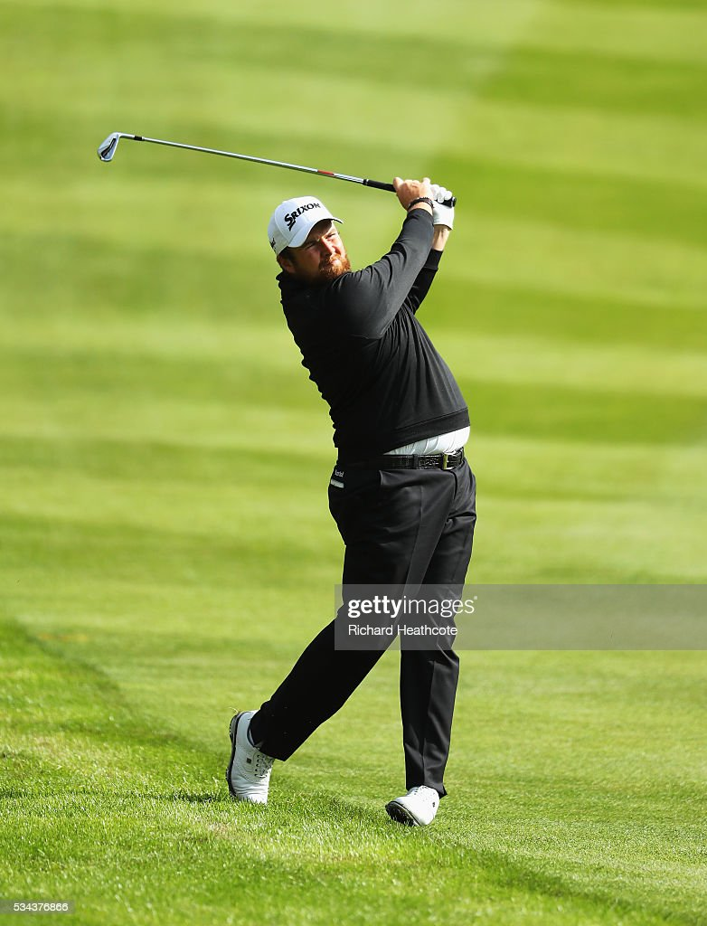 <a gi-track='captionPersonalityLinkClicked' href=/galleries/search?phrase=Shane+Lowry+-+Golfer&family=editorial&specificpeople=12866010 ng-click='$event.stopPropagation()'>Shane Lowry</a> of Ireland hits his 2nd shot on the 4th hole during day one of the BMW PGA Championship at Wentworth on May 26, 2016 in Virginia Water, England.