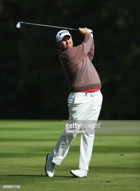 Shane Lowry of Ireland hits his 2nd shot on the 9th hole during day three of the BMW PGA Championship at Wentworth on May 24 2014 in Virginia Water...