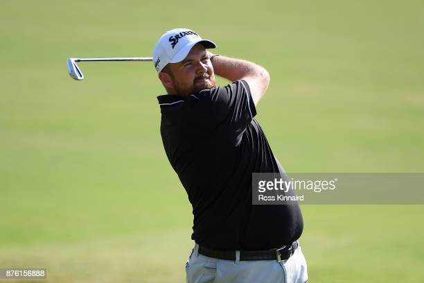 Shane Lowry of Ireland hits his second shot on the 18th hole during the final round of the DP World Tour Championship at Jumeirah Golf Estates on...