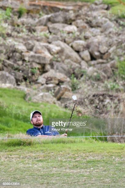 Shane Lowry of Ireland hits out of a hazard off the 18th hole during round one of the World Golf Championships Dell Technologies Match Play at Austin...