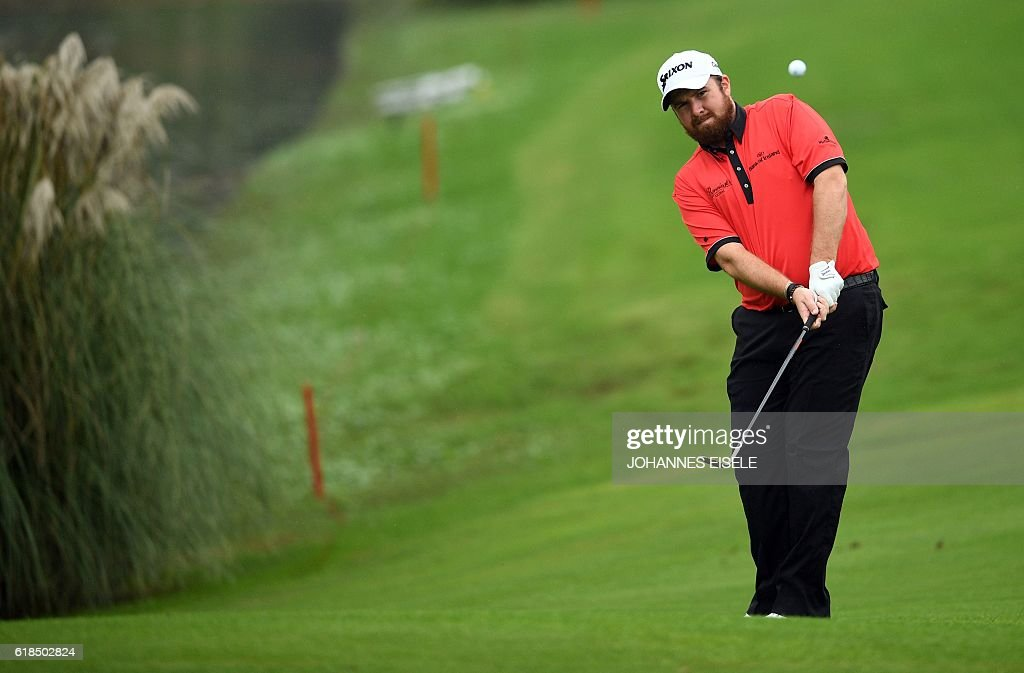 Shane Lowry of Ireland hits the ball at the World Golf Championships-HSBC Champions golf tournament in Shanghai on October 27, 2016. / AFP / JOHANNES