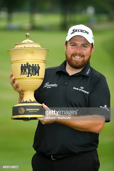 Shane Lowry of Ireland holds the Gary Player Cup after winning the World Golf Championships Bridgestone Invitational during the final round at...