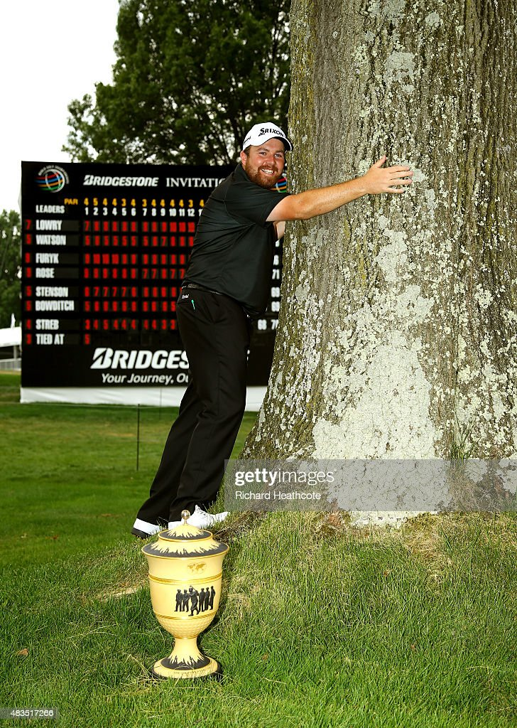 Shane Lowry of Ireland hugs a tree near the 18th green with the Gary Player Cup after winning the World Golf Championships - Bridgestone Invitational during the final round at Firestone Country Club South Course on August 9, 2015 in Akron, Ohio. Lowry finished with a score of -11.