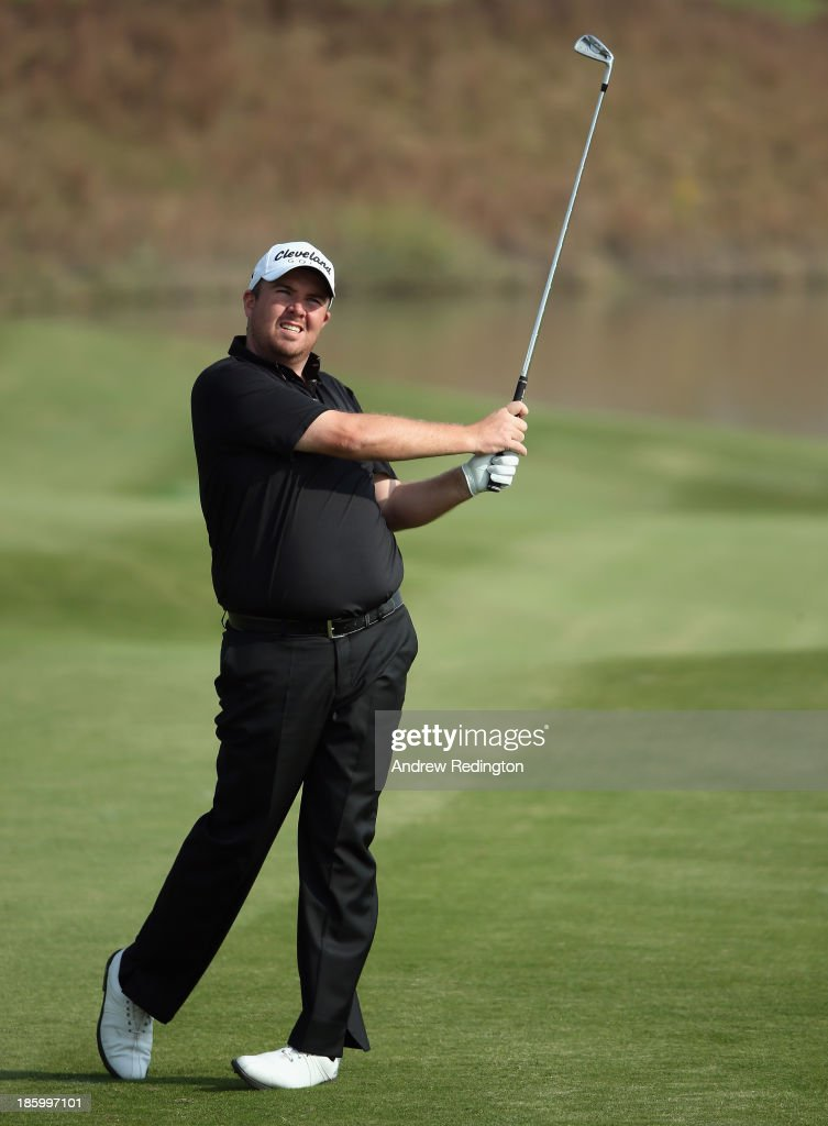 <a gi-track='captionPersonalityLinkClicked' href=/galleries/search?phrase=Shane+Lowry+-+Golfer&family=editorial&specificpeople=12866010 ng-click='$event.stopPropagation()'>Shane Lowry</a> of Ireland in action during the final round of the BMW Masters at Lake Malaren Golf Club on October 27, 2013 in Shanghai, China.