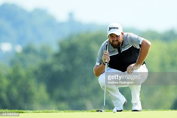 Shane Lowry of Ireland lines up a putt on the third hole during the final round of the US Open at Oakmont Country Club on June 19 2016 in Oakmont...
