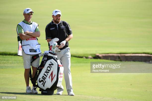 Shane Lowry of Ireland looks down the 18th hole with caddie Dermot Byrne during the final round of the DP World Tour Championship at Jumeirah Golf...