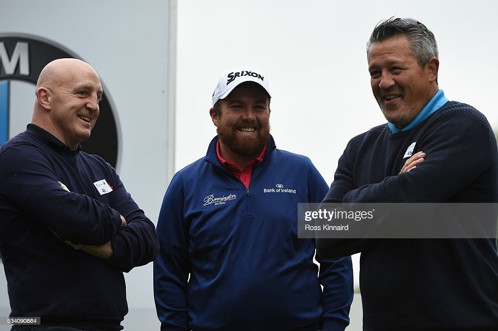 <a gi-track='captionPersonalityLinkClicked' href=/galleries/search?phrase=Shane+Lowry+-+Golf&family=editorial&specificpeople=12866010 ng-click='$event.stopPropagation()'>Shane Lowry</a> of Ireland looks on with <a gi-track='captionPersonalityLinkClicked' href=/galleries/search?phrase=Keith+Wood&family=editorial&specificpeople=855185 ng-click='$event.stopPropagation()'>Keith Wood</a> (L) and <a gi-track='captionPersonalityLinkClicked' href=/galleries/search?phrase=Zinzan+Brooke&family=editorial&specificpeople=781933 ng-click='$event.stopPropagation()'>Zinzan Brooke</a> (R) during the Pro-Am prior to the BMW PGA Championship at Wentworth on May 25, 2016 in Virginia Water, England.