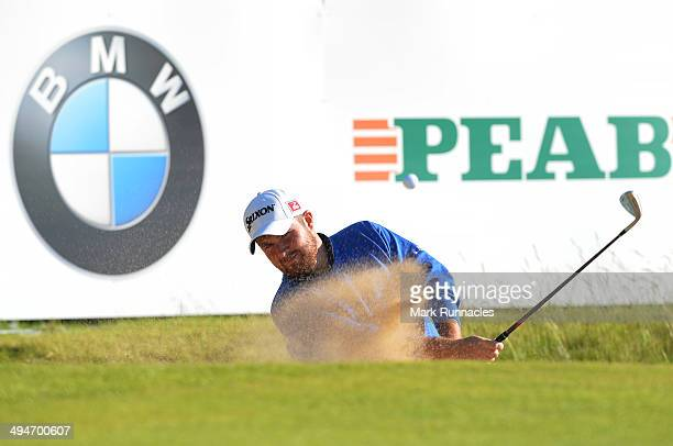 Shane Lowry of Ireland plays a bunker shot at the 18th green during the Nordea Masters at the PGA Sweden National on May 30 2014 in Malmo Sweden