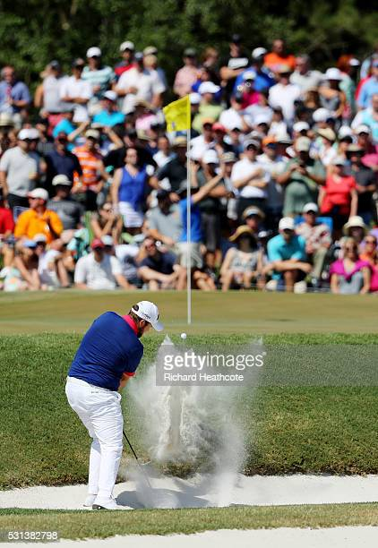 Shane Lowry of Ireland plays a shot from a bunker on the seventh hole during the third round of THE PLAYERS Championship at the Stadium course at TPC...