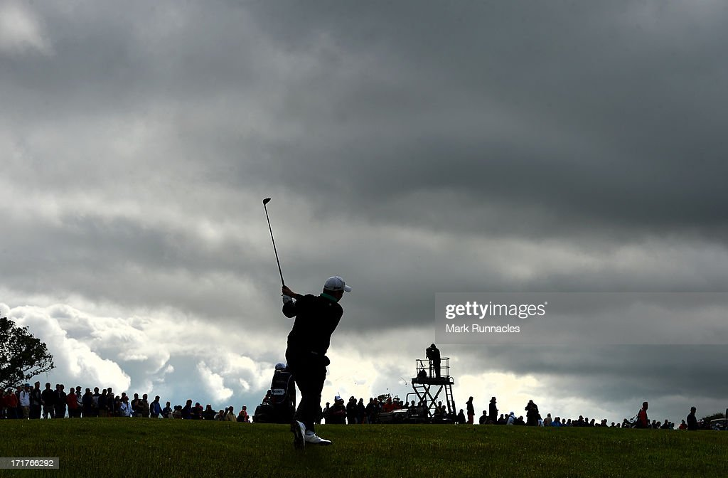 <a gi-track='captionPersonalityLinkClicked' href=/galleries/search?phrase=Shane+Lowry+-+Golfer&family=editorial&specificpeople=12866010 ng-click='$event.stopPropagation()'>Shane Lowry</a> of Ireland plays his approach shot to the 18th during the Second Round of the Irish Open at Carton House Golf Club on June 28, 2013 in Maynooth, Ireland.