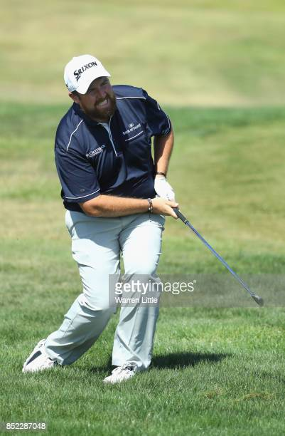 Shane Lowry of Ireland plays his second shot into the ninth green during the Portugal Masters at the Oceanico Victoria Golf Club on September 23 2017...