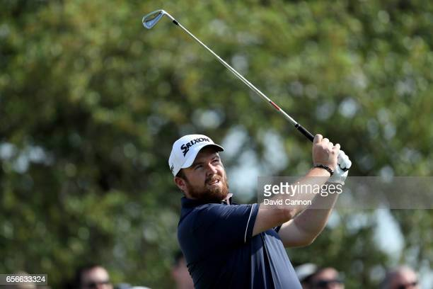 Shane Lowry of Ireland plays his tee shot on the par 3 7th hole in his match against Sergio Garcia during the first round of the 2017 Dell Match Play...