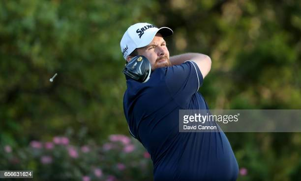Shane Lowry of Ireland plays his tee shot on the par 4 18th hole in his match against Sergio Garcia during the first round of the 2017 Dell Match...