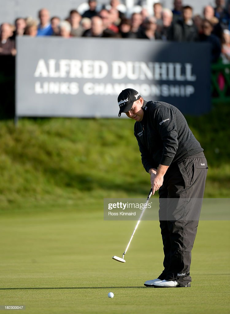 <a gi-track='captionPersonalityLinkClicked' href=/galleries/search?phrase=Shane+Lowry+-+Golfer&family=editorial&specificpeople=12866010 ng-click='$event.stopPropagation()'>Shane Lowry</a> of Ireland putting on the 18th green during the final round of the Alfred Dunhill Links Championship on The Old Course, at St Andrews on September 29, 2013 in St Andrews, Scotland.