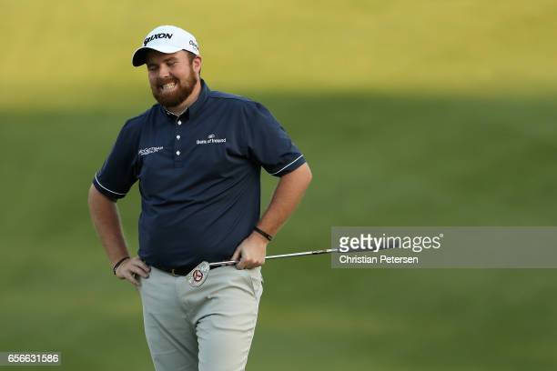 Shane Lowry of Ireland reacts after missing a putt on the 18th hole of his match during round one of the World Golf ChampionshipsDell Technologies...