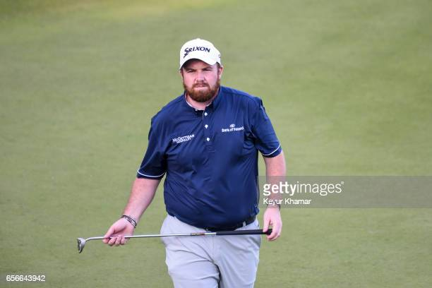 Shane Lowry of Ireland reacts to his putt on the 17th hole green during round one of the World Golf Championships Dell Technologies Match Play at...