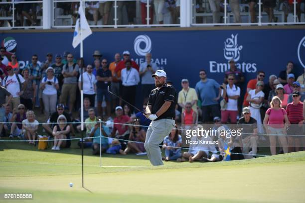 Shane Lowry of Ireland reacts to his third shot on the 18th hole uring the final round of the DP World Tour Championship at Jumeirah Golf Estates on...