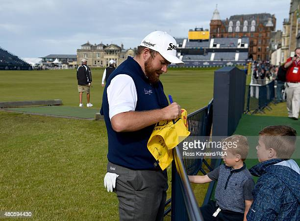 Shane Lowry of Ireland signs his autograph for young fans ahead of the 144th Open Championship at The Old Course on July 13 2015 in St Andrews...
