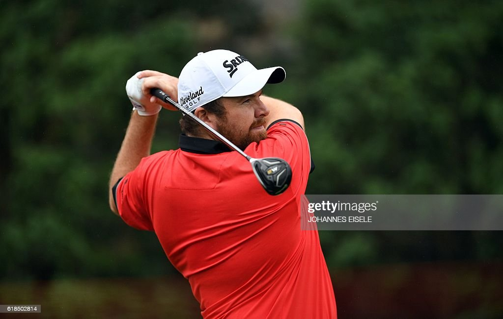 Shane Lowry of Ireland tees off at the World Golf Championships-HSBC Champions golf tournament in Shanghai on October 27, 2016. / AFP / JOHANNES