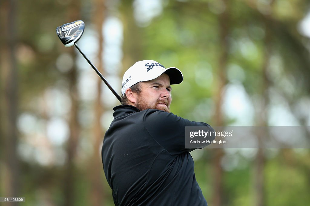 <a gi-track='captionPersonalityLinkClicked' href=/galleries/search?phrase=Shane+Lowry+-+Golfer&family=editorial&specificpeople=12866010 ng-click='$event.stopPropagation()'>Shane Lowry</a> of Ireland tees off on the 11th hole during day one of the BMW PGA Championship at Wentworth on May 26, 2016 in Virginia Water, England.