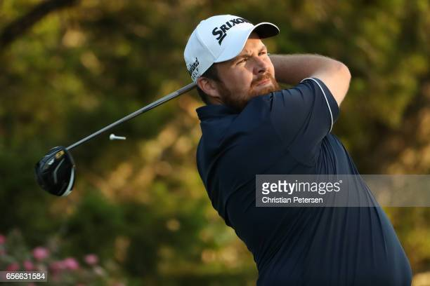 Shane Lowry of Ireland tees off on the 18th hole of his match during round one of the World Golf ChampionshipsDell Technologies Match Play at the...