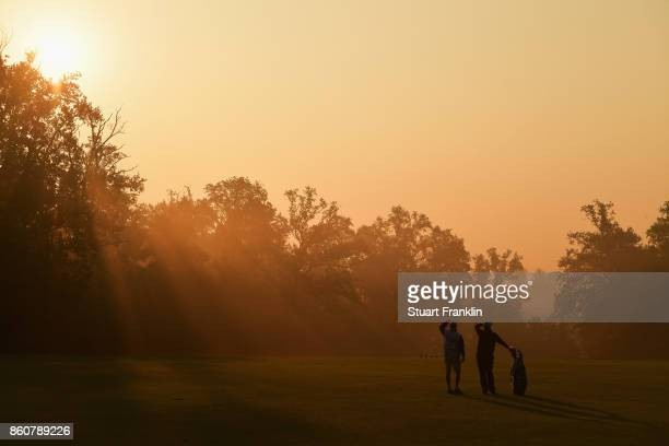 Shane Lowry of Ireland waits to play a shot with his caddie during day two of the Italian Open at Golf Club Milano Parco Reale di Monza on October 13...