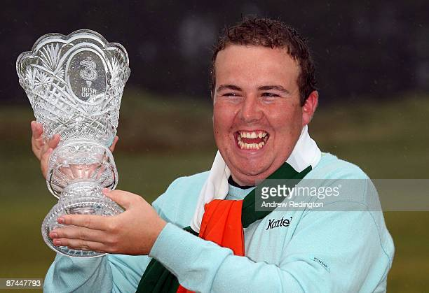 Shane Lowry of Ireland with the winners trophy after winning on the third playoff hole during the final round of The 3 Irish Open at County Louth...