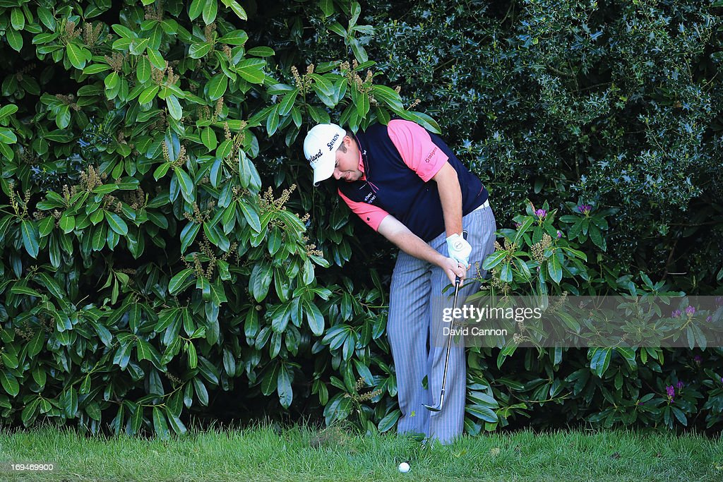 <a gi-track='captionPersonalityLinkClicked' href=/galleries/search?phrase=Shane+Lowry+-+Golfer&family=editorial&specificpeople=12866010 ng-click='$event.stopPropagation()'>Shane Lowry</a> of Republic of Ireland hits his 2nd shot on the 18th hole during the third round of the BMW PGA Championship on the West Course at Wentworth on May 25, 2013 in Virginia Water, England.