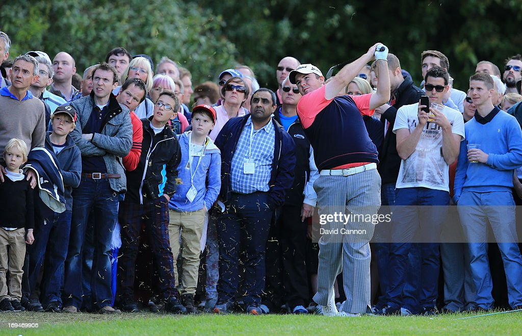<a gi-track='captionPersonalityLinkClicked' href=/galleries/search?phrase=Shane+Lowry+-+Golfer&family=editorial&specificpeople=12866010 ng-click='$event.stopPropagation()'>Shane Lowry</a> of Republic of Ireland hits his 3rd shot on the 18th hole during the third round of the BMW PGA Championship on the West Course at Wentworth on May 25, 2013 in Virginia Water, England.