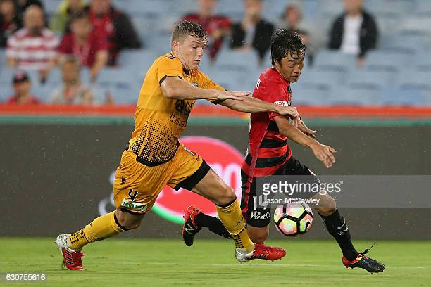 Shane Lowry of the Glory and Jumpei Kusukami of the Wanderers compete for the ball during the round 13 ALeague match between the Western Sydney...