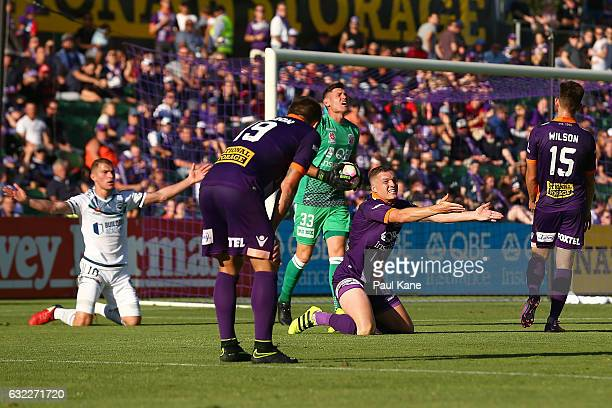 Shane Lowry of the Glory pleads with Referee Peter Green after bringing taking down James Troisi of the Victory in a tackle during the round 16...