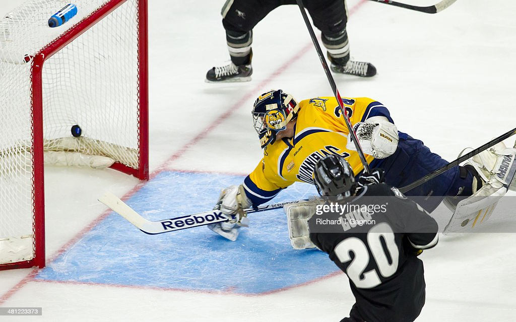 Shane Luke #20 of the Providence College Friars scores a goal on Michael Garteig #34 of the Quinnipiac University Bobcats during the NCAA Division I Men's Ice Hockey East Regional Championship Semifinal at Webster Bank Arena on March 28, 2014 in Bridgeport, Connecticut.