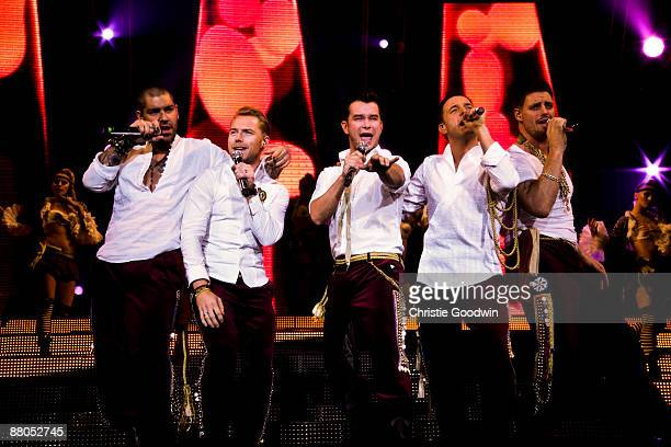 Shane Lynch Ronan Keating Stephen Gately Mikey Graham and Keith Duffy of Boyzone perform on stage at Wembley Arena on May 29 2009 in London England