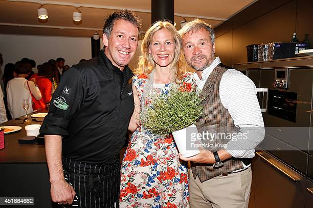 Shane Mcmahon Katharina Schwarz and Thomas Darchinger attend the Bulthaup Showroom Opening on July 03 2014 in Munich Germany