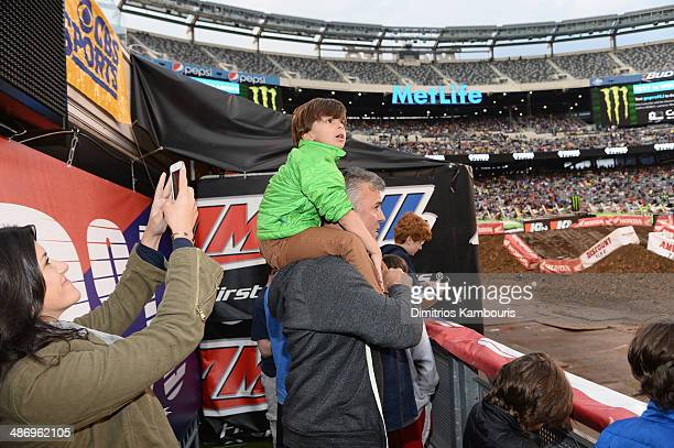 Shane McMahon of YOU on demand formely WWE Pro Wrestler watches the race while his wife Marissa MazzolaMcMahon takes a picture during Monster Energy...