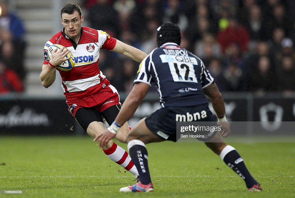 Shane Monahan of Gloucester runs at Sam Tuitupou of Sale during the Aviva Premiership match between Gloucester and Sale Sharks at the Kingsholm Stadium on November 24, 2012 in Gloucester, England.
