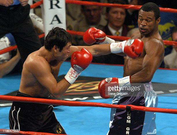 Shane Mosley avoids a blow from Oscar De La Hoya during Shane Mosley Defeats Oscar De LaHoya to Claim WBC and WBA 154Pound Titles at MGM Grand Arena...