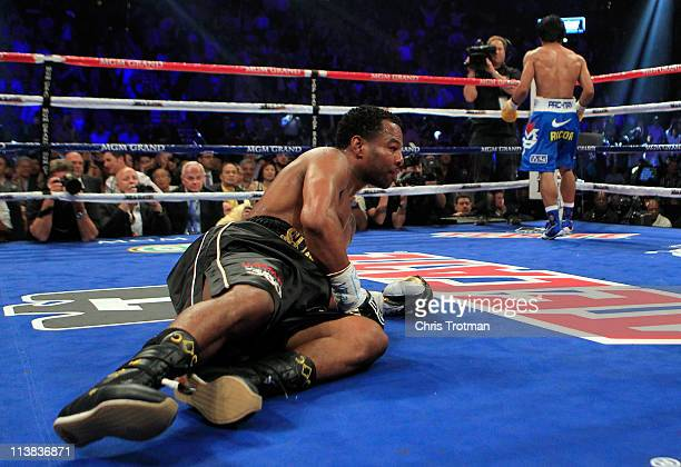 Shane Mosley is knocked down in the third round by Manny Pacquiao of the Philippines in the WBO welterweight title fight at MGM Grand Garden Arena on...